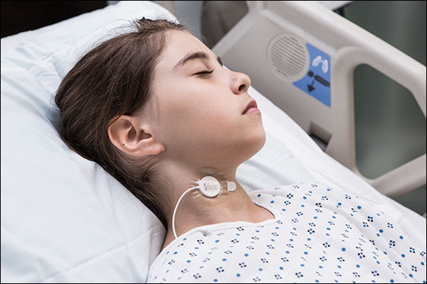 Masimo - Acoustic Respiration Rate - small child in hosiptal bed with RRa sensor on neck