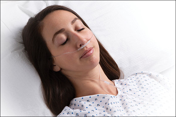 Masimo - NomoLine Capnography woman laying in hospital with nasal